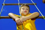 Young Boy Climbing a Rope Ladder.