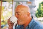 Bald Man Sipping Coffee