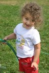 Young Smiling Girl with Water Hose